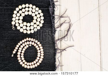 Pearl Necklace on wood background. Studio Photo