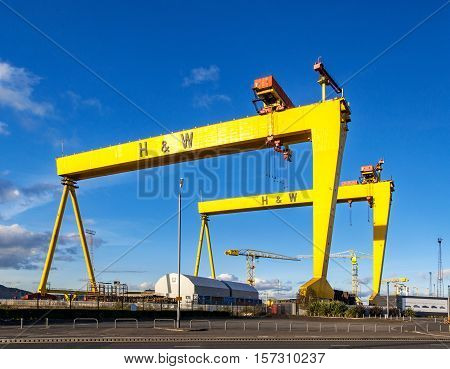 BELFAST NORTHER IRELAND UK - OCTOBER 2, 2016: Samson and Goliath. Twin shipbuilding gantry cranes in Titanic quarter famous landmark of Belfast Norther Ireland. Goliath is in the foreground.