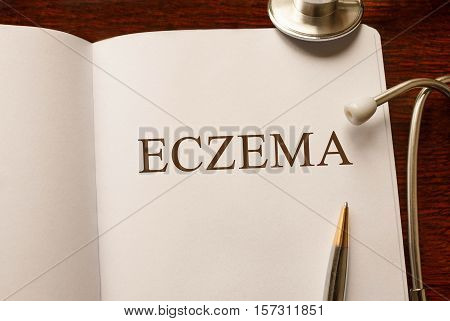 Page with Eczema on the table with stethoscope medical concept