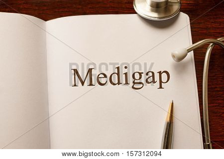 Page with Medigap on the table with stethoscope medical concept