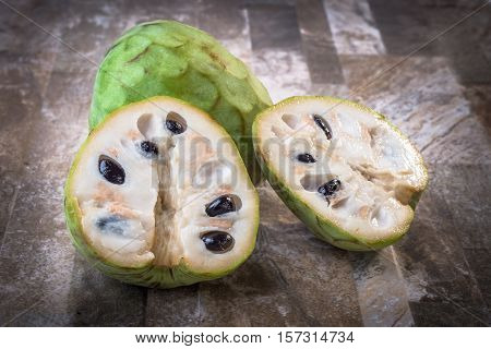 Fresh swet fruit Cherimoyas on stone background