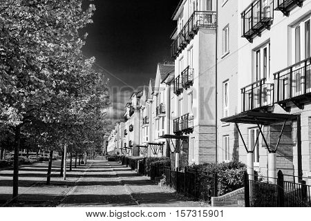 Modern new terraced houses and apartment flats in Cardiff, Wales, UK, black and white image