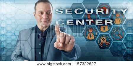 Friendly male corporate agent with toothless smile is touching the words SECURITY CENTER on an interactive control screen monitor. Information technology concept and business services metaphor.