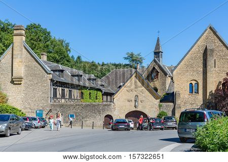 ORVAL BELGIUM - AUGUST 23 2016: Entrance famous Orval Abbey in Belgian Ardennes. The abbey is famous for its trappist beer botanical garden and ruins