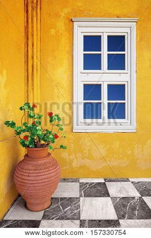 Exterior Detail of a Yellow Old House with Checkerboard Patio