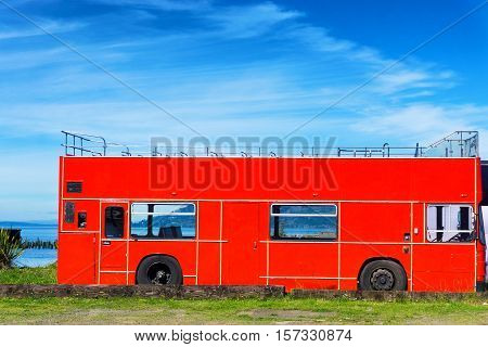 View of an old red bus in Astoria Oregon
