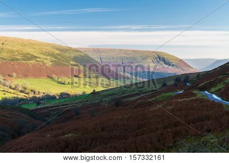 Looking down at valley evening sunlight autumn fall. Gospel Pass in the Black Mountains near Hay on Wye Powys Wales United Kingdom Europe.