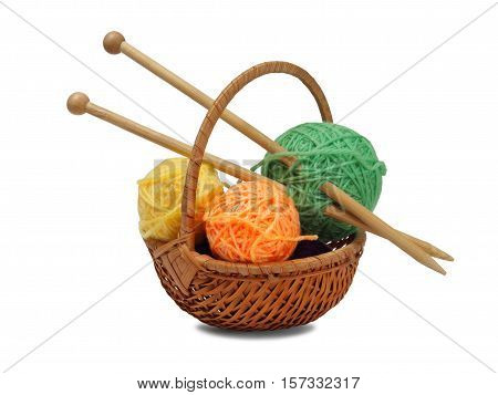 Basket with knitting wool and needles on white background