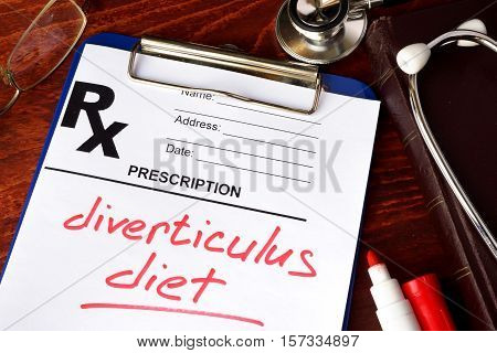 Prescription form with words diverticulitis diet on a table.