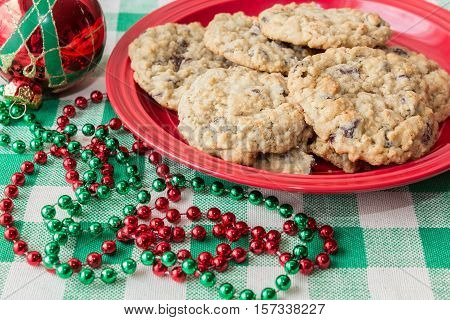 red plate of cookies with christmas decor