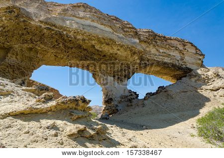 Huge natural rock arch at Lake Arco, Angola. Several of those kind of rock formations can be found in the area.