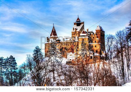 Beautiful view over the famous castle of Dracula in Bran town Transylvania region Romania in winter season poster