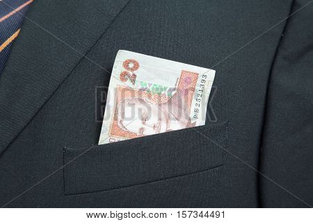 Twenty Ukrainian Hryvnia in the pocket of a suit