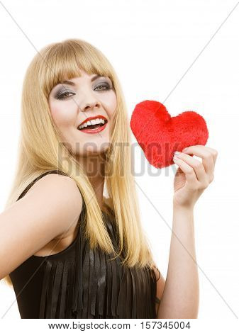 Woman elegant blonde long hair girl dark makeup red lipstick holding red heart love symbol flirting studio shot on white. Valentines day happiness concept