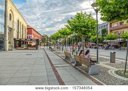 PRISTINA, KOSOVO - JULY 04, 2015: People walking on newly renovated Mother Teresa street in the city center.