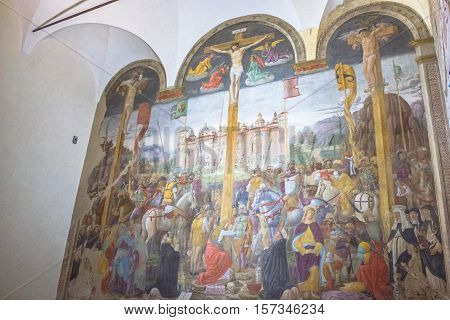 Milan, Italy - November 15, 2016: The Crucifixion mural painting of Giovanni Donato Montorfano in the Refectory of Santa Maria Delle Grazie Italian church.