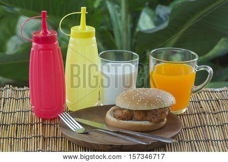 Spicy Chicken Burger with milk anf orange juice
