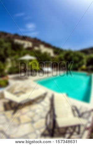 Abstract blurred photo of a Swimming Pool under Blue Summer Sky ready for background use