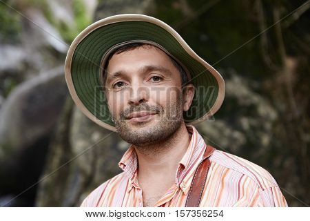 Good-looking Botanist Exploring Wildlife Of Rainforest In Tropical Country, Working On Scientific St