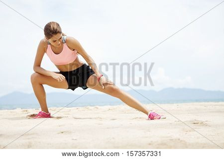Young Female Runner With Beautiful Fit Body Warming-up Her Muscles Before Strength Training Cardio W