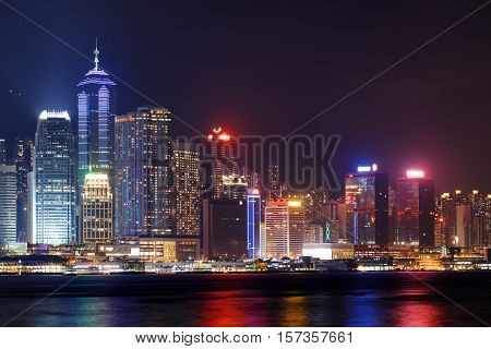 Night View Of Hong Kong Island Skyline From Kowloon Side