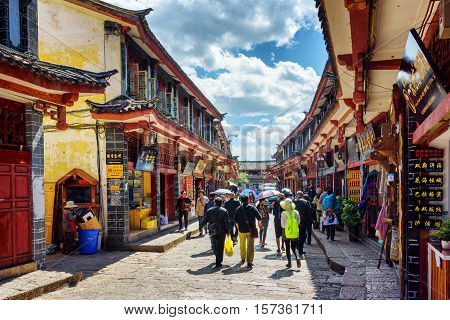 Asian Tourists Are Walking On Street In The Old Town Of Lijiang
