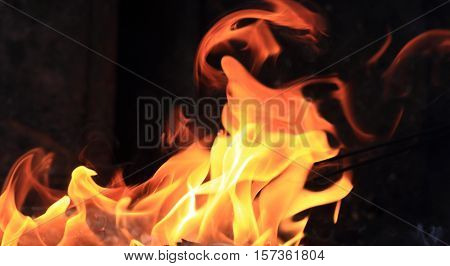 close up of burning fire flames against black background