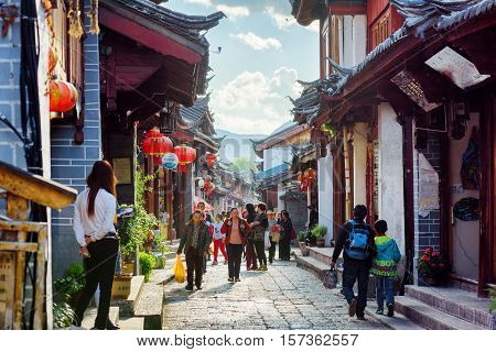 Locals At A Scenic Street In The Old Town Of Lijiang, China