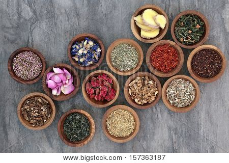 Herb tea collection in wooden bowls also used in natural alternative medicine.