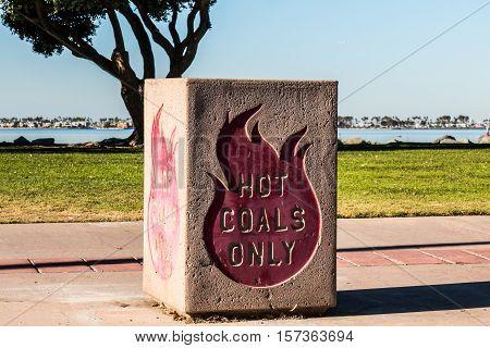 Hot coals disposal bin at a bayside park in California.