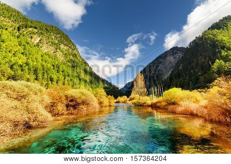 Amazing River With Azure Crystal Clear Water Among Mountains