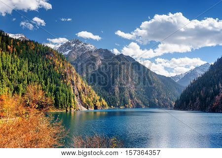 Beautiful View Of The Long Lake Among Fall Woods And Mountains