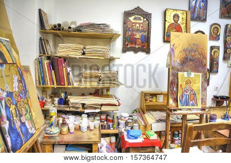 METEORA GREECE - March 13.2016: Ready icons and designs in the icon masterful of souvenir shop