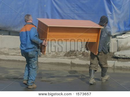 Two Workers And The Table
