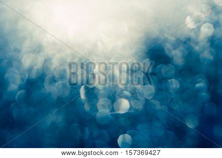 Abstract bokeh background, blue color, sunny glitter