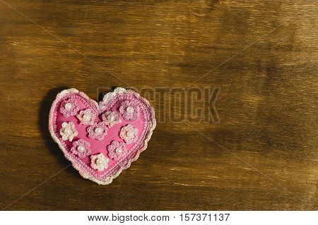 Pink Heart Of Handwork On A Wooden Background