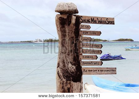Signage board on an Island beach showing water sports facilities.