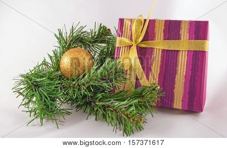 Christmas and New Year composition of Christmas tree branches, golden ball and gift box