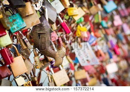 Close up of padlocks at a bridge as a symbol of everlasting love