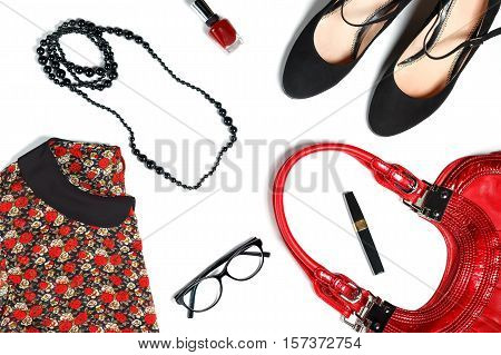 Female clothes and look essentials - silk blouse, black high heels, red leather bag, red lipstick, glasses