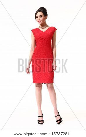 woman with updo hair style in cocktail party red drink dress high heel shoes stand full body length isolated on white