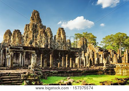 Stone Faces Of Ancient Bayon Temple In Angkor Thom, Cambodia