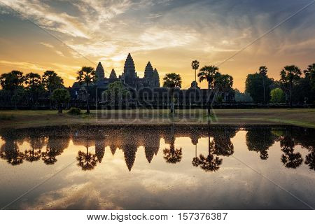 Angkor Wat Reflected In Lake At Dawn. Siem Reap, Cambodia