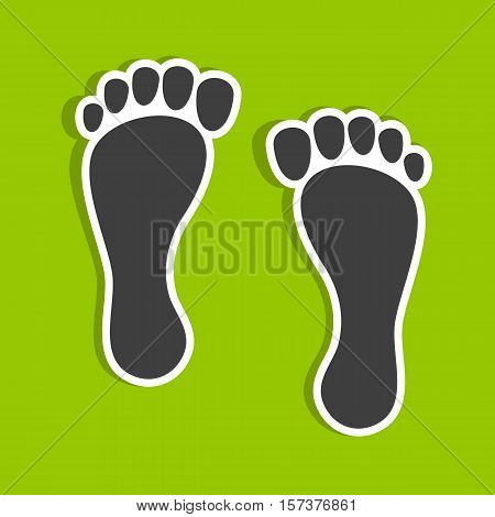 Footprints on a green background. Footprints in the form of stickers.