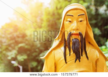 Closeup View Of Golden Buddha Statue In Sunlight On Nature Background In Hong Kong