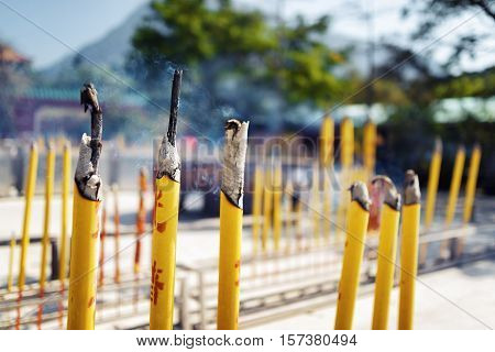 Burning Incense Sticks During Prayer At The Buddhist Temple In Hong Kong