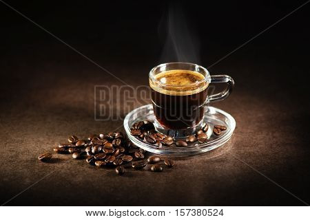 Cup of espresso coffee on dark background.