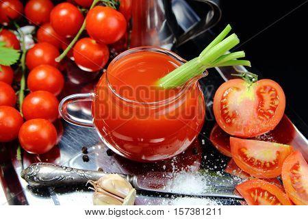 tomato juice with celery, fresh tomatoes, garlic and salt