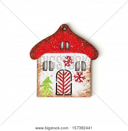 Little decorative house isolated on the white background. Symbolic object. Winter decoration.