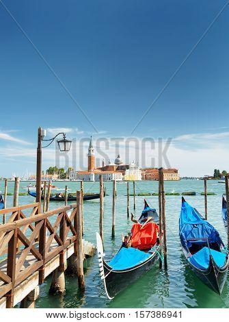 Gondolas Parked At Pier Beside The Riva Degli Schiavoni, Venice